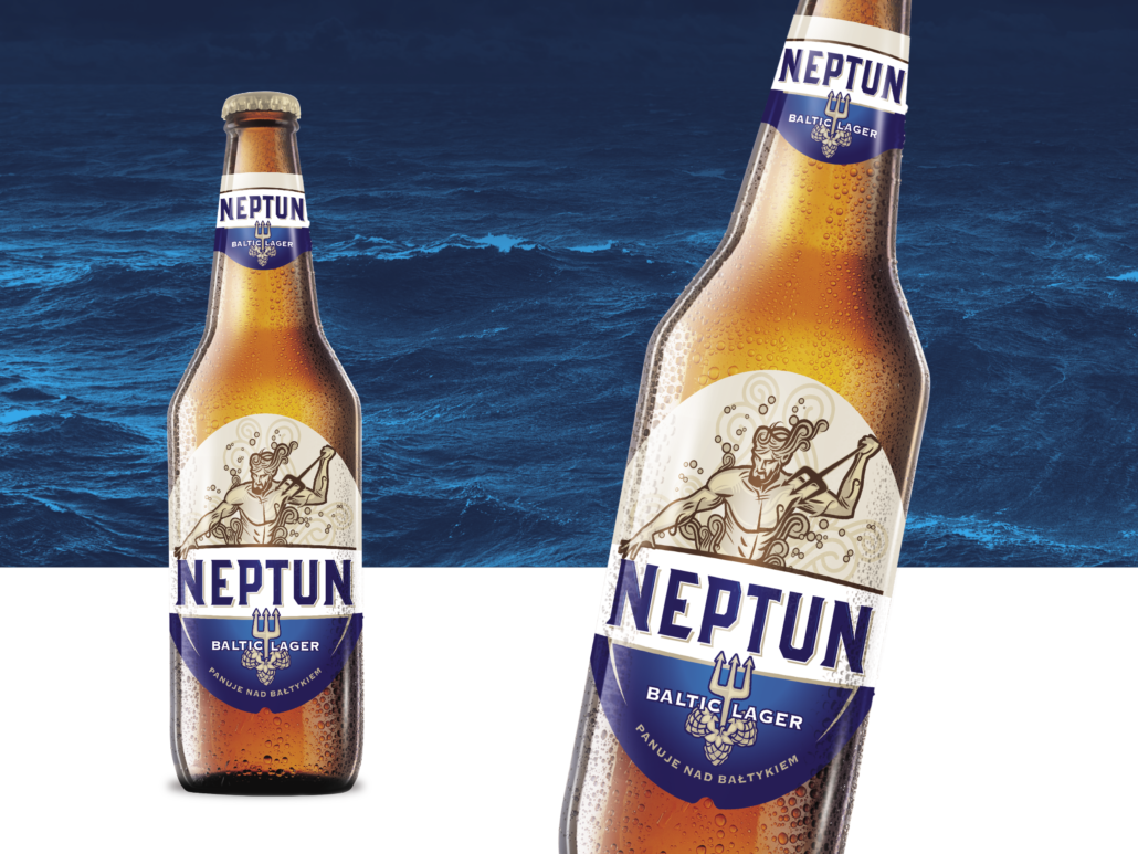 brown Neptun beer bottle with blue and white label, sea in the background