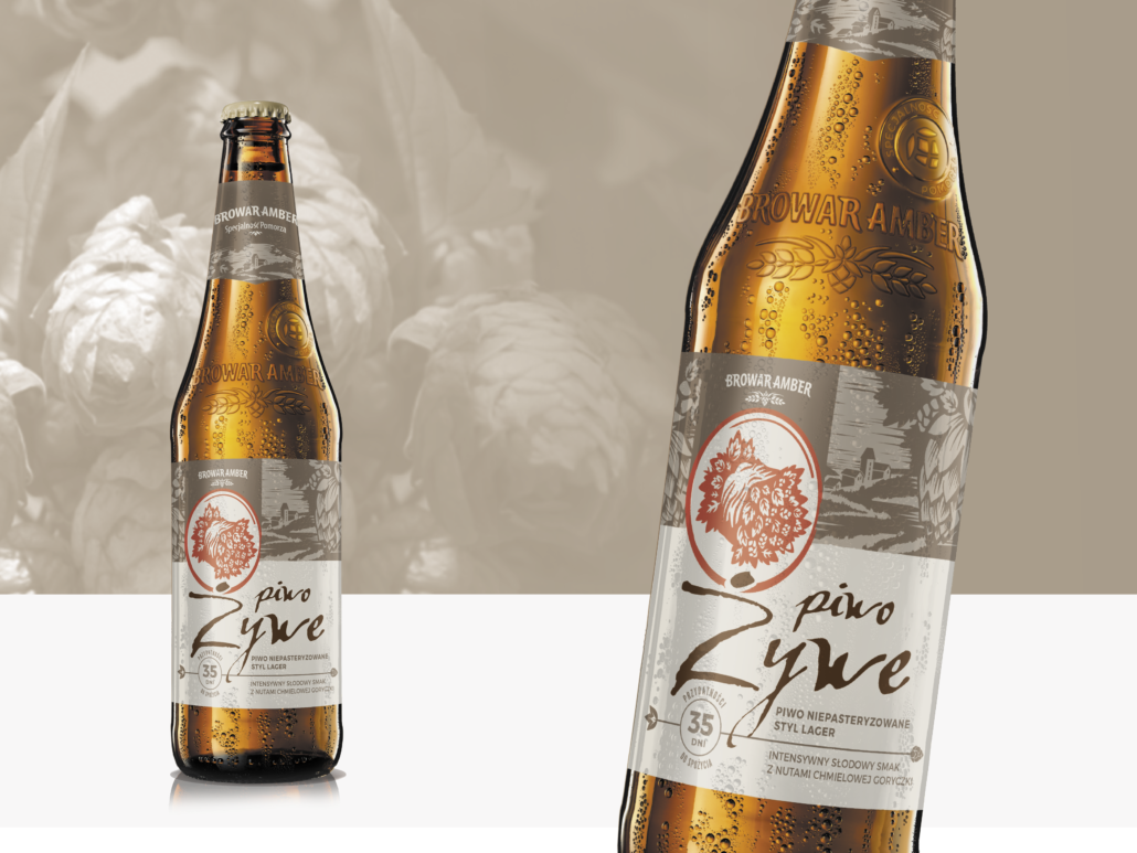 A brown Żywe beer bottle with a brown and beige label