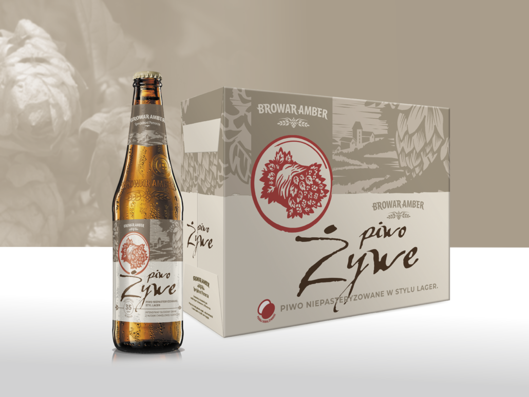 A brown Żywe beer bottle with a brown and beige label and next to it is a beige beer carton