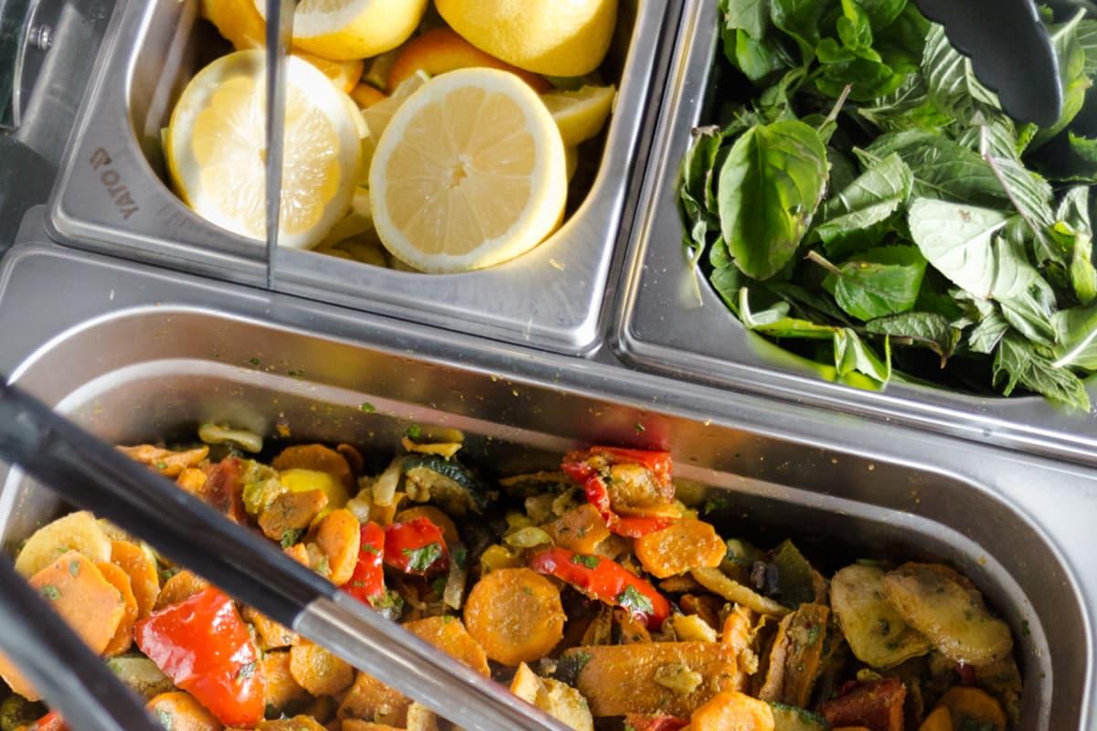 Kebab additions: halved lemons, lettuce and other vegetables